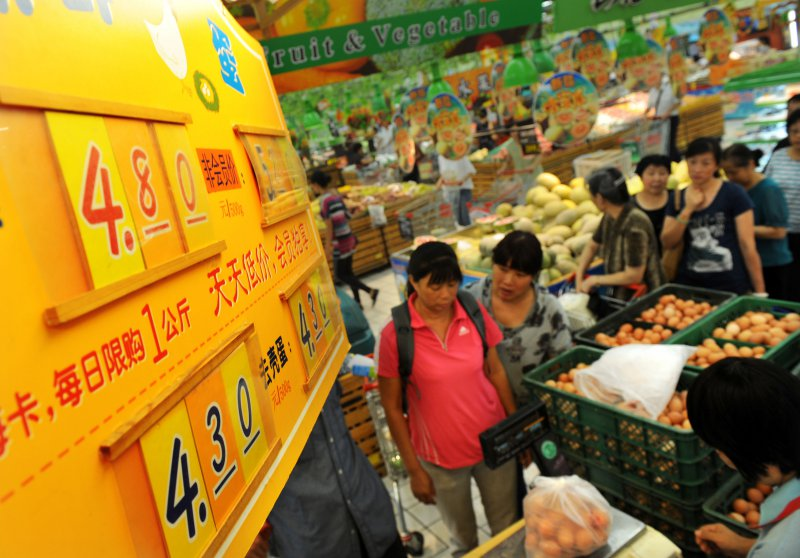 China revises 2013 GDP up by 3.4 pct