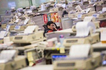 Hong Kong Exchanges profit surges 73 pct in H1