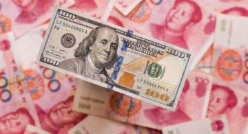 China plays down yuan depreciations trade impact