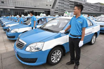 Chinese city scraps franchise fees to break taxi monopoly