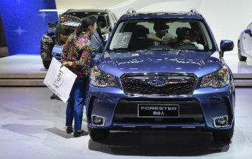 Chinas vehicle-purchase tax cut to benefit buyers, automakers: Moodys