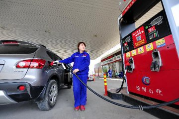 China cuts benchmark product oil prices effective Wed.