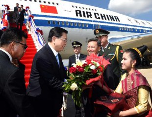 China, Laos pledge to further develop ties