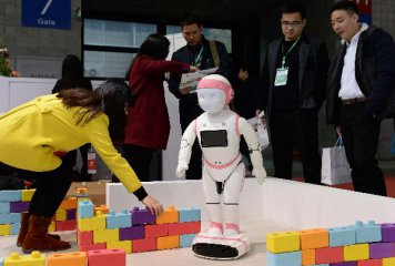 China vows to increase market occupancy of industrial robots to over 50 pct