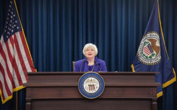 U.S. Fed raises federal funds rate by 25bp, first rate hike since 2006