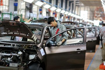 Caixin China manufacturing PMI edges down to 49.4