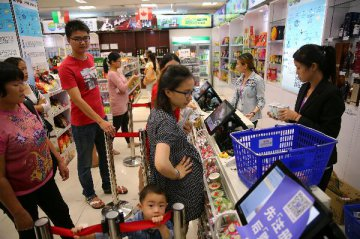 News Analysis: Chinas rising middle-income group to spur slowing economy