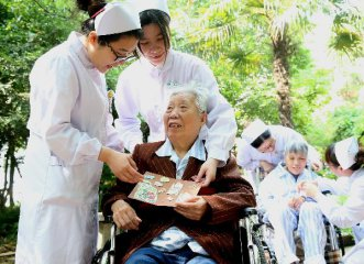 Xi underscores challenge, opportunity of aging population