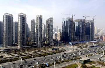 China's property investment slightly cools, sales booming