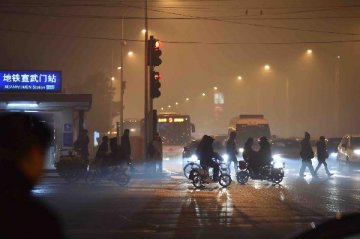Beijing to reduce PM2.5 density by 30 pct