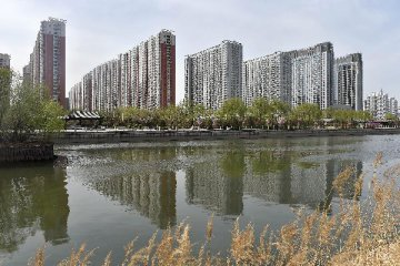Two China cities tighten housing purchase