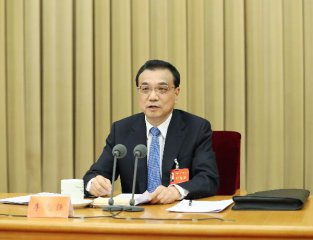 Premier Li: More dynamic market cornerstone for development