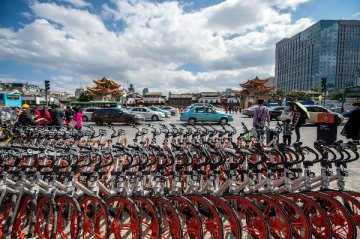 A-share listed companies compete to set foot in bike-sharing business