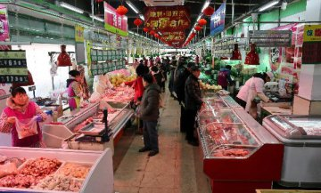 Chinas steady inflation creates room for financial risk control