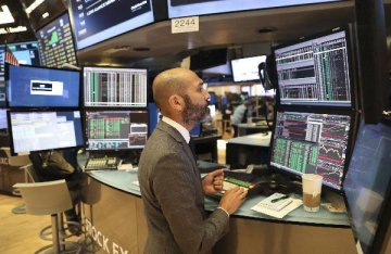 Dow hits fresh record close, dollar falls after U.S Fed raises rates