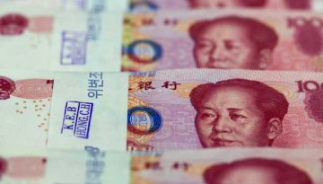 China remains calm in face of U.S. rate hike