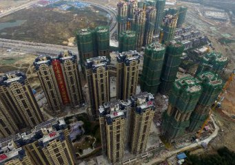 Chinas property development investment continues slower growth