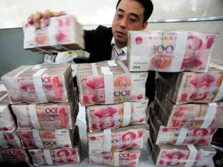 Chinas M2 growth slows, new loans stable