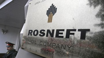 Russias top oil producer  Rosneft buys stake in Indian oil giant