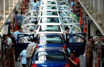 China to further open financial,NEV sectors to foreign investment