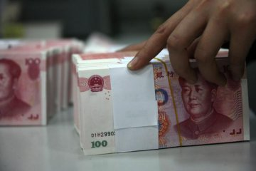 Chinas new yuan loans rise, M2 growth continues to slow