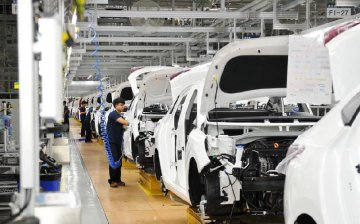 Chinas GDP expands 6.9 pct in first 3 quarters