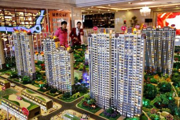 Chinas property investment, sales slow in first ten months