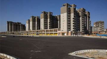 Chinas property market to cool on tough curbs
