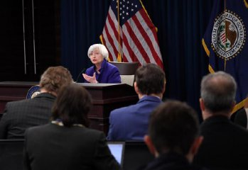 U.S. Fed raises interest rate, forecasts 3 hikes in 2018