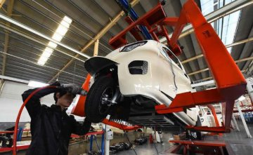 Chinas manufacturing activity expands slower in December