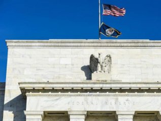 U.S. Fed minutes show officials divided over pace of rate hikes in 2018