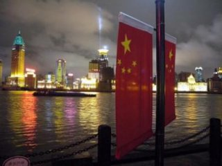 China to further reduce SOE debts