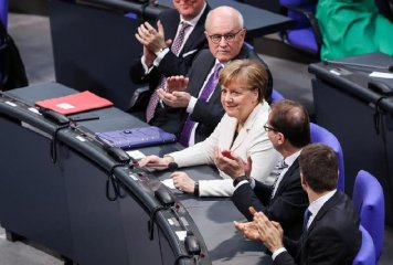 Merkel narrowly re-elected as German chancellor for fourth term