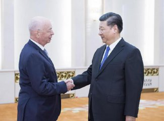 ​​Xi meets Schwab, vows greater opening up