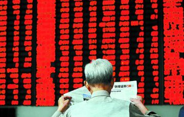 Chinese shares close higher at midday