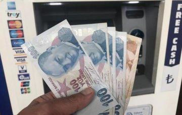 Turks mixed reaction to sharp depreciation of lira under U.S. pressure