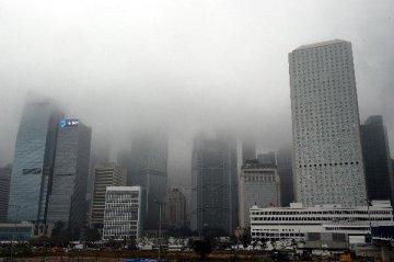Hong Kongs economic outlook darken on rising rates,US-China trade worries