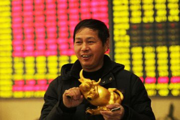 China allows foreigners to trade A-shares next month