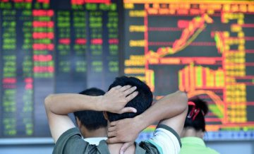 Chinese shares open slightly lower Tuesday