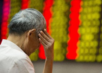 Chinese shares close lower at midday