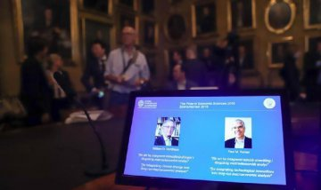 2018 Nobel laureates in economics address growth slowdown, global warming