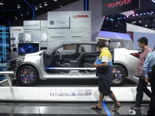 """China says slow auto sales growth to continue as """"new normal"""""""