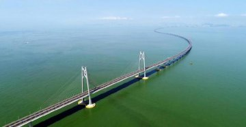 Worlds longest cross-sea bridge opens,integrating Chinas Greater Bay Area