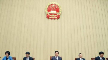 Top legislature reviews state-owned assets reports