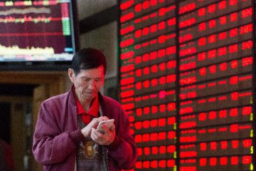 ​Chinese shares close higher Friday