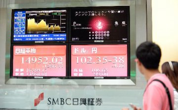Tokyo stocks open sharply lower, Wall Streets plunge weighs