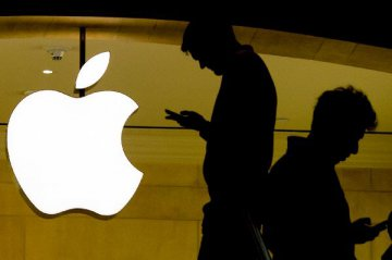 Shares of Apple dive more than 9 pct after revenue forecast cut
