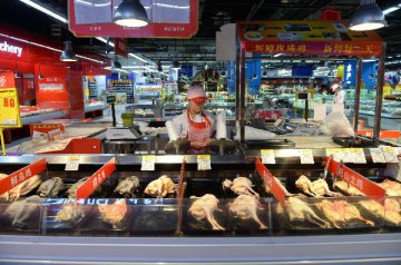 Intl retail giants go digital to woo consumers