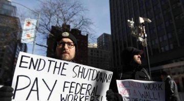 U.S. asks furloughed employees to return to work amid shutdown