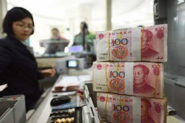 Chinese banks forex settlement deficit narrows in December